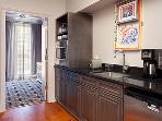 Kitchenette comes equipped with dishes, coffeemaker, microwave,  toaster, refrigerator.
