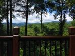 Year-round long range mountain views from the wrap-around deck