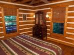 Master bedroom overlooks hot tub