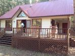 Cabin has wrap-around deck with cedar rockers for gorgeous view of creek--great fishing!