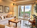 Spacious great room with living and dining areas leading out to the main terrace