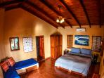 Master bedroom #1 with king bed and attached shared bath with views of the surf break