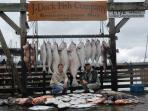 Owner Marc and son Christian pose with boat catch in Seward
