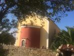 AN OLD MONASTRY IN THE OLIVE GROVES