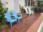 patio with round table, umbrella, chairs BBQ