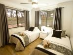 The third bedroom has two single beds which can be put together to make a king bed if preferred.