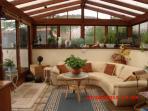 Sun lounge with doors to balcony terrace
