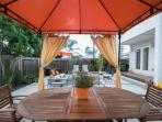 Outside dining table in private enclosed backyard.