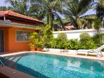 View on garden with 2.25 meter high wall surrounding the whole property and bed for taking sun