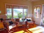 Morning light floods the sunroom for a wonderful morning breakfast nook!