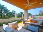 There are several open air covered seating areas all around the villa