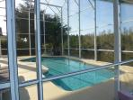Pool backing onto small lake and conservation
