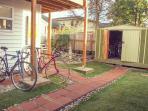 2nd floor deck overlooks garden. Rent bikes to explore the most bike-friendly city in US
