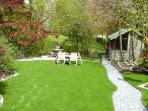 Lower terrace and lawn in private screened garden.  Barbecue