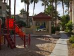 kids playground and pool area, steps from the condo