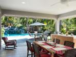 veranda by the pool with dining and BBQ grill