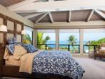 Large bedroom with ocean view.