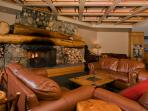 Rustic fireplace, sitting area on lower level of the building nearby health club