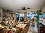 Island inspired tropical decor.  Oceanfront wall of glass overlooking Banyan's Surf Break and reef!