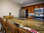 Slab granite counter tops, stainless steel appliances, large pantry for storage, washer and dryer.