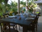 Outside dining table on the verandah - al fresco style