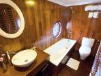 The en-suite bathroom in all cabins is fully supplied with high quality amenities