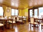The cosy restaurant and bar area offers a designed atmosphere to enjoy the culinary experience