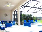 Lots of room on the pool deck and plenty of tables and chairs for all of the family to relax.