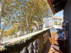 Balcony with table and chairs to relax  and enjoy the view of the Douro River and Arrabida Bridge