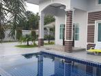 Beautiful swimming pool with water features