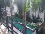 view of the outdoor pool from balcony