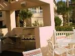 Ground floor BBQ terrace by the beach; with 4 stainless steel BBQ, sink, and tables