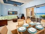 Dining and living room with a wall of glass doors that all open up making it true indoor outdoor living, perfect to...