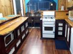 FULLY SELF CONTAINED KITCHEN DISHWASHER GAS COOKING REFRIDGERATOR MICROWAVE OVEN BREAKFAST BAR