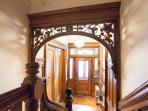 Entry foyer and your apartment doors.