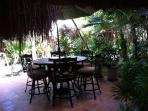A lovely outdoor patio for enjoying your meals in your tropical paradise