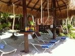 Don't have to worry about reserving a lounger for the day.  Your palapa with loungers are waiting!