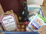 Welcome basket and honesty box for our latest guests
