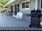 BBQ grill area with hanging swing chairs