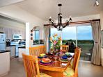 The separate dining room overlooks the terrace with gas grill and has seating for 6.