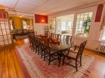 The Formal Dining Room opens into the sun room and living room and card room.