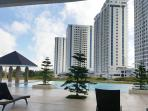 Outdoor pool with view of the 4 towers of Wind Residences