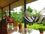Covered lounging area downstairs with hammocks