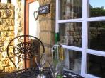 Enjoy a lovely glass of wine in the tranquil courtyard. A sun spot in the summer from noon.