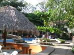 Another view of pool bar a few steps from our unit. Howler monkeys arrive each evening in trees