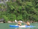 Kayaking while on a Halong Bay cruise