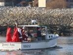 Mr. and Mrs. Santa Clause arrive by lobster boat with Luewy and Lucy Lobster