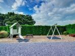 A shared play area is available for younger guests, to one side of the courtyard at the front of the cottages