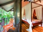 'Red Corrals' bedroom by the jungle deck at villa Ginger.