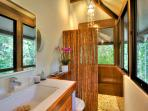 Bathroom with jungle views at villa Ginger.